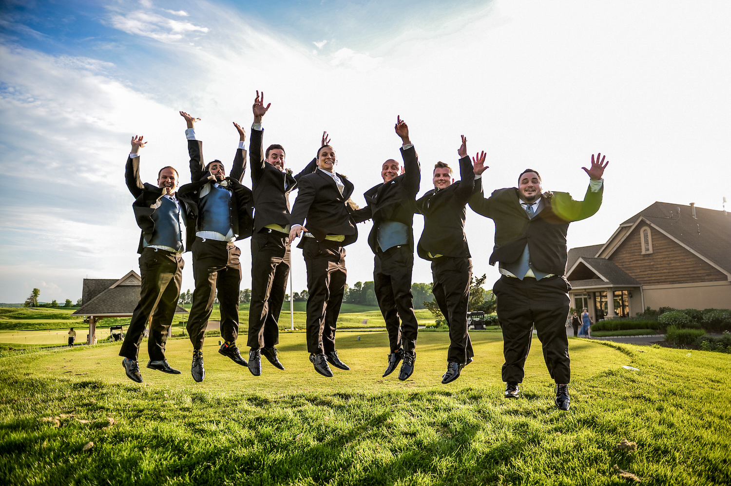 nj-wedding-photographers-nicole&mike-groomsmen-jumping-outside