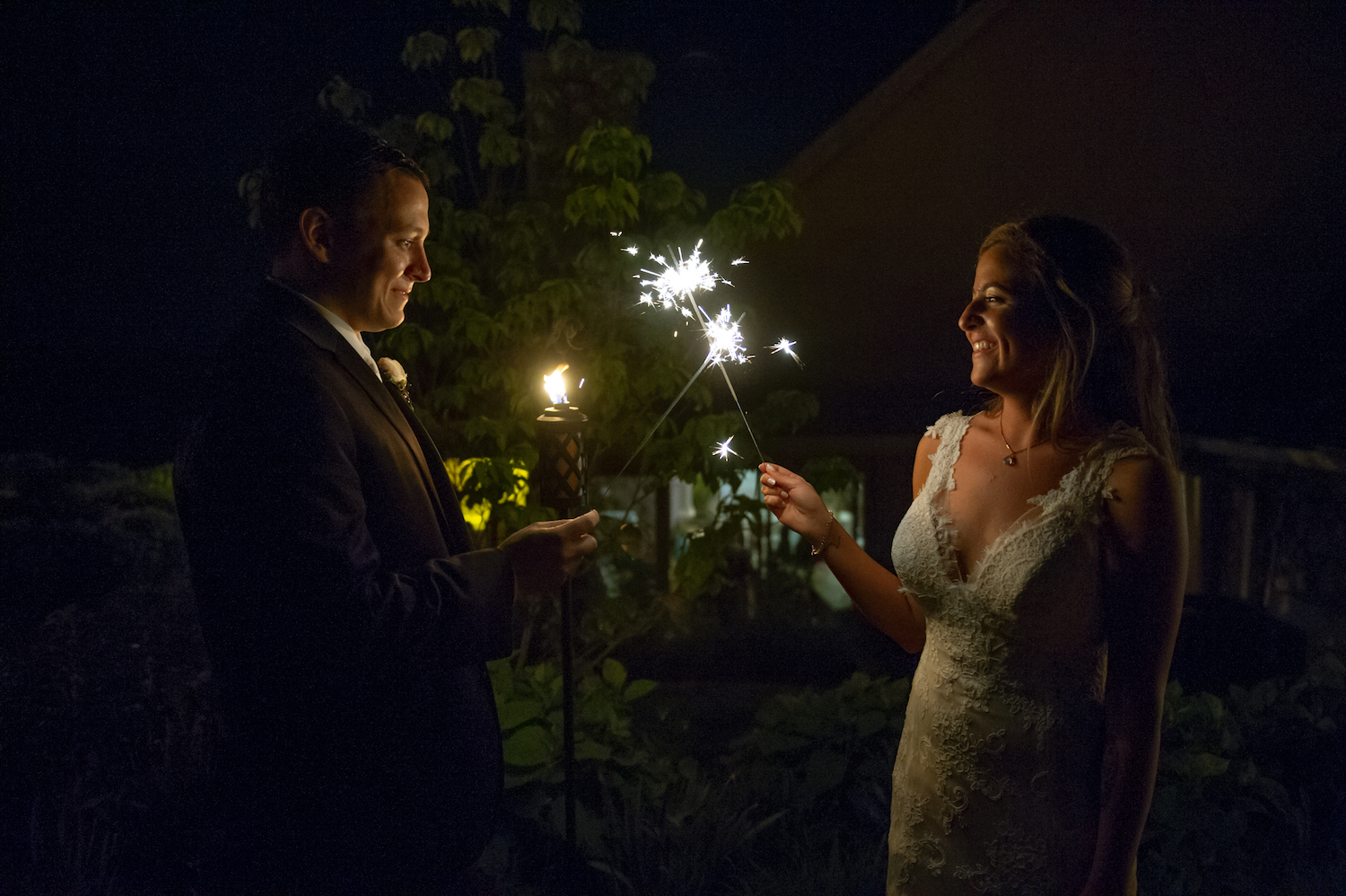 nj-wedding-photographers-nicole&mike-touching-sparklers-night