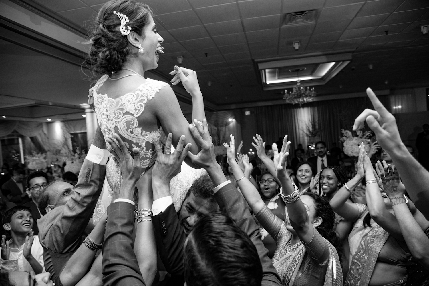 ny-wedding-photographers-neha&binu-bride-lifted-by-guests-dance-floor-reception