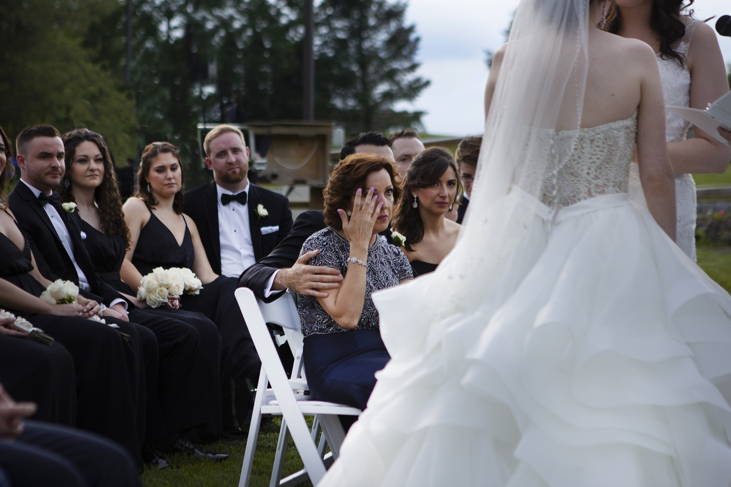 nj-wedding-photographers-cailin&graciela-guest-watching-couple-at-altar-crying-ceremony