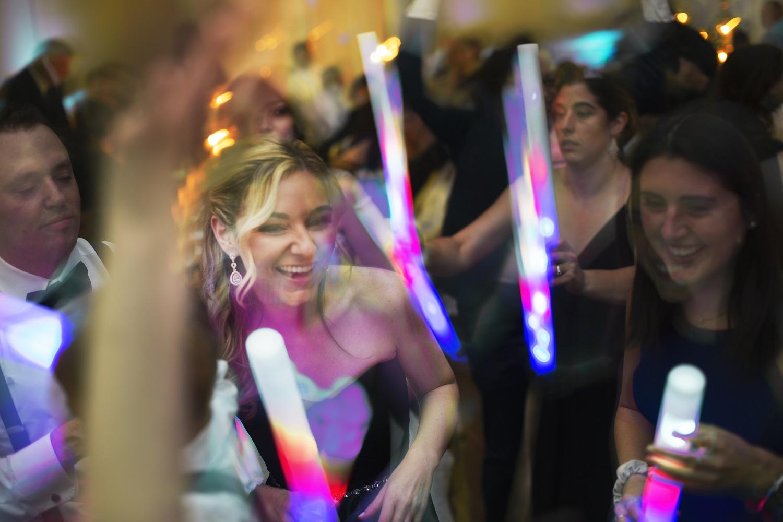 nj-wedding-photographers-cailin&graciela-guests-dancing-light-sticks